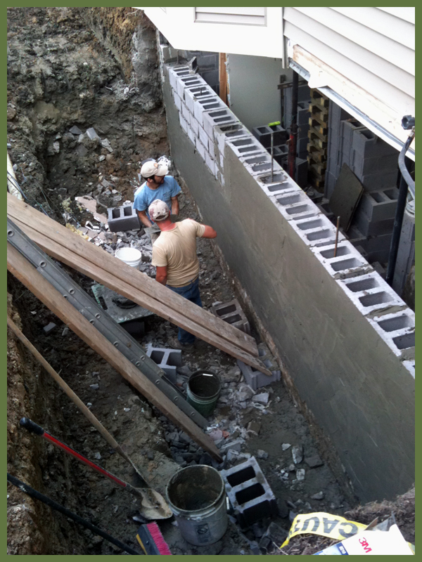 Wall reconstruction with vertical reinforcement built in
